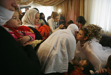 Israeli Druze Arwad Abu Shahin, 25,  is kissed by relatives before her wedding, in the northern Druze village of Buqata