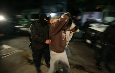 Federal police arrest two men on suspicion of possessing drugs during an anti-narcotics operation in Mexico City