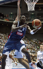 France's Pietrus goes up to the basket past Greece's Fotsis during their quarter-final game at the world basketball championships in Saitama