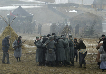 Military enthusiasts take part in a re-enactment of a World War Two battle in Goroshki