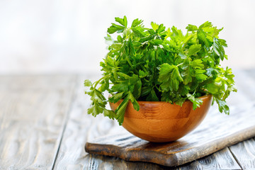 Parsley leaves in a wooden bowl.