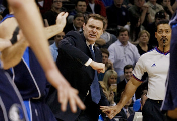 Dallas Mavericks head coach Carlisle lifts his elbow to help official Kennedy see his players battle against Oklahoma City Thunder during their NBA basketball game in Oklahoma City