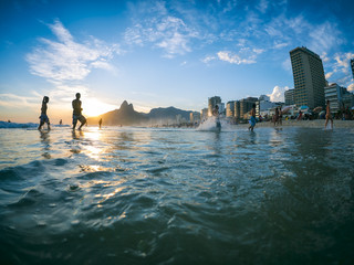 Silhouettes walking on the shore of Ipanema Beach in Rio de Janeiro, Brazil