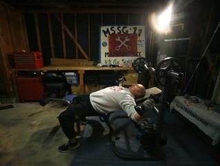 Iraq war veteran Ken Sargent works out in his garage at home