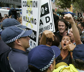 Protesters shout at police during a demonstration outside the Sydney Town Hall