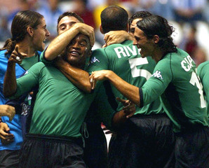 REAL BETIS' BRAZILIAN ASSUNCAO IS CONGRATULATED BY TEAM MATES AFTERSCORING GOAL AGAINST DEPORTIVO ...