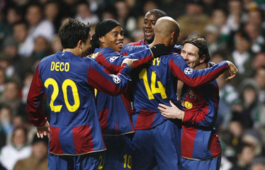 Barcelona's Messi celebrates with team mates after scoring against Celtic during Champions League match at Celtic Park stadium in Glasgow
