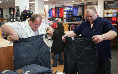 Sumo wrestlers try on clothes in New York