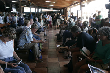 Tourists wait to be sent to Galapagos' main port