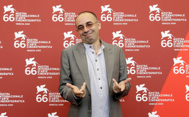 Italian movie director Giuseppe Tornatore poses during a photocall at the Venice Film Festival