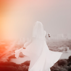 bride in white dress on cityscape background