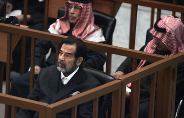 Saddam sits in court during continuation of his 'Anfal' genocide trial in Baghdad