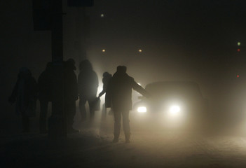People wait at a bus stop at temperature of around minus 40 degrees Celsius in the Siberian town of Novy Urengoy