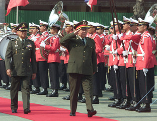 CHINA'S DEFENCE MINISTER CHI SALUTES IN BANGKOK.