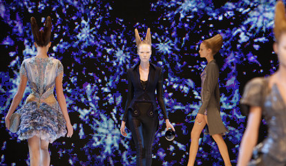 Models present creations by British designer Alexander McQueen as part of his Spring/Summer 2010 women's collection during Paris Fashion Week