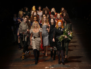 Designer Westwood walks down the catwalk with models after 2009 Autumn/Winter collection during London Fashion Week