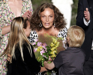 U.S. fashion designer Von Furstenberg receives flowers after showing a preview of her 2009 resort wear collection in Florence