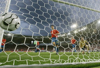 Spain's Iker Casillas (R), Sergio Ramos (15) and Pablo Ibanez (22) look at the ball after a [goal by..