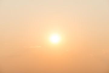gold sky with the sun