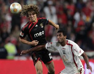 Benfica's David Luiz fights for the ball with Leiria 's Carlao Silva during their Portugal Premier League soccer match at Magalhaes Pessoa stadium in Leiria