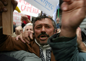 Albanian Cam demonstrators shout slogans during a protest in front of the Greek Embassy in Tirana