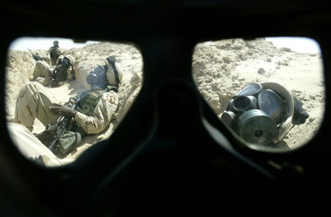 SOLDIERS OF 101ST AIRBORNE DIVISION SEEN THROUGH GAS MASK DURINGSCUD ATTACK DRILL IN KUWAITI DESERT.