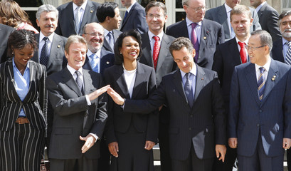 France's President Sarkozy poses with officials of the International Contact Group on Sudan/Darfur at the Elysee Palace in Paris