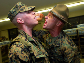Marine Corps drill instructor yells at recruit in Parris Island after wakeup.