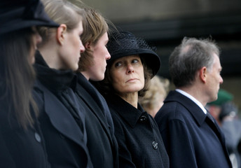 Christina Rau widow of Former German President Johannes Rau look at her children in front of the Berlin Dom