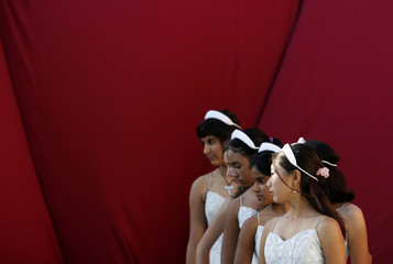 School girls perform during a play in Havana