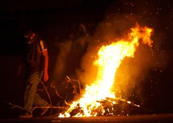 Protester of Popular Assembly walks past barricade near of University Benito Juarez in Oaxaca City