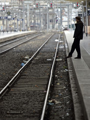 A commuter waits for a train at the Marseille's railway station