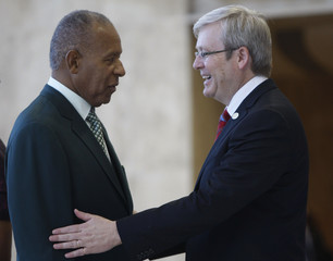 Manning welcomes Rudd at the National Academy in Port-Of-Spain