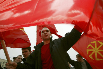 Far-right demonstrators wave flags during a rally on National Unity Day in Russia's southern city of Stavropol