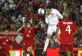 Tottenham Hotspur's Berbatov scores the second goal against Hapoel Tel Aviv during their UEFA Cup Group G soccer match in Tel Aviv