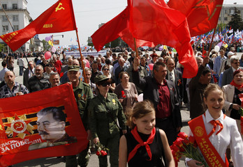 People take part in May Day rally in rebel-held Luhansk