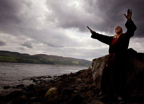 WHITE WITCH KEVIN CARLYON PERFORMS AN INVOCATION ON THE BANKS OF LOCHNESS.