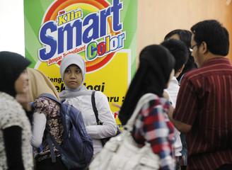 Students submit job applications during a job fair for new graduates at Pelita Harapan University in Tangerang