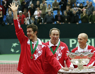 Members of the Russian team pose with the trophy as they celebrate their victory over Argentina in the Davis Cup final tennis match in Moscow