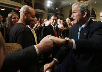 U.S. President George W. Bush greets attendees at the American Enterprise Institute in Washington