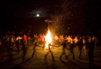 Belarussians sing and dance around campfire during Ivana Kupala festival near Rakov