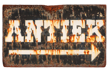 Vintage rusted sign with the Dutch word 'Antiques' isolated on white