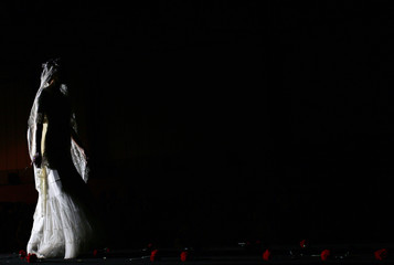 Model presents creation from Angeles Espinar during International Flamenco Fashion Show in Seville