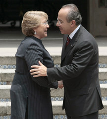 Chile's President Michelle Bachelet shakes hands with Mexican President Felipe Calderon after a news conference at the presidential residence Los Pinos in Mexico City