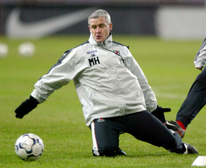 WALES MANAGER MARK HUGHES TRAINS AT THE LOKOMOTIV STADIUM IN MOSCOW.