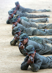 Shan State Army soldiers practice at the Shan State Army's Doi Tailang headquarters in Shan State along the Myanmar-Thai border