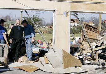 U.S. President George W. Bush walks through a tornado-damaged neighborhood in Tennessee