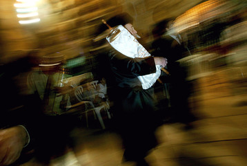 Ultra-Orthodox Jews dance with the Scroll of the Torah in Jerusalem