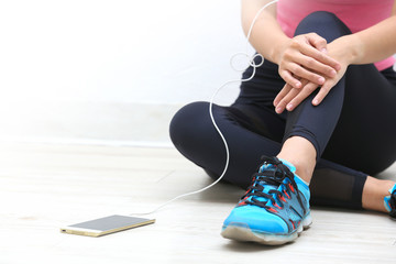 Fitness woman listen music on mobile phone at gym  after exercise working out.