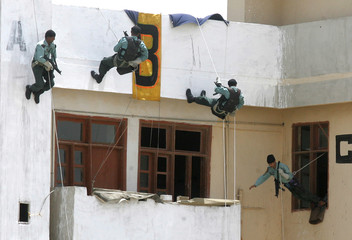 Members of the Pakistan Ranger's Anti Terrorist Force exhibit their skills during a demonstration in Karachi